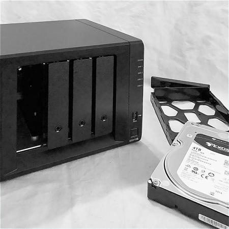 Image of Synology DS918+ with hard disk drive.